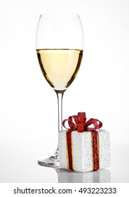 White wine glass with christmas gift box  decoration  on white background