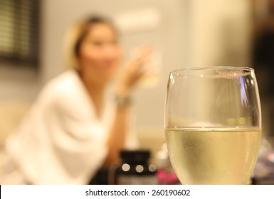 White wine glass with lipstick print on glass