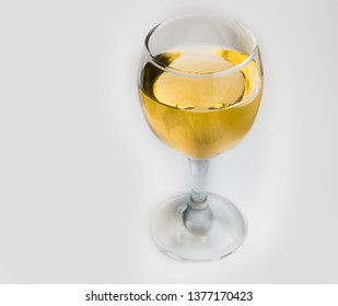 White wine in glass glass on white background