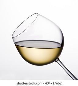 White wine glass on white background,