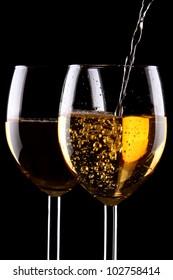 White wine glasses on black