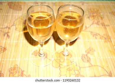White wine glasses on the table beautiful background of drink