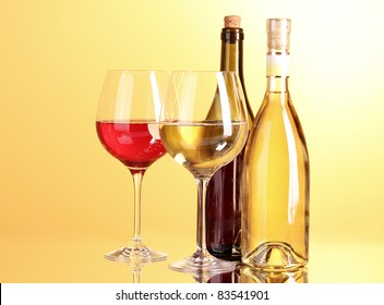 White wine on yellow background