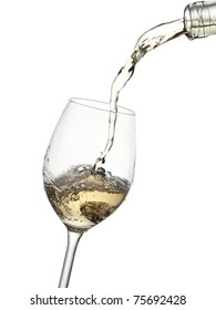 White wine pouring into a glass from a bottle