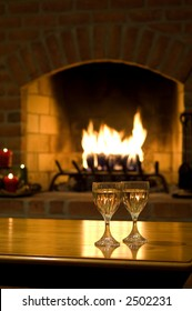 White wine and a warm, intimate fire set the scene for a romantic evening
