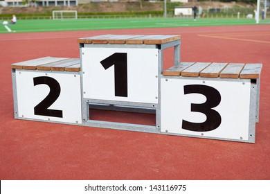 white winners podium standing on soccer field