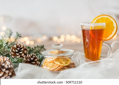 White winter composition with pine cones and glass of tea