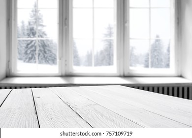 white winter window with a wooden table and a place for an advertising product