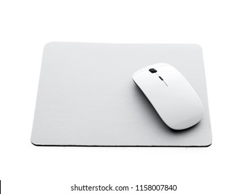 White wireless mouse on a mouse pad isolated on a white background