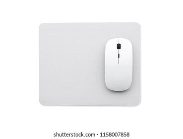 White wireless mouse on a mouse pad isolated on a white background, top view