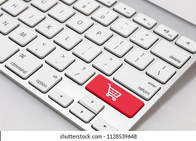 """White wireless  style keyboard with red """"shopping cart"""" symbol key"""