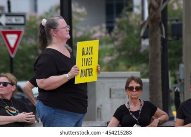 White woman holding a sign/protestig at a Black Lives Matter rally on the Ocala Square in Ocala Florida on 17 July 2016