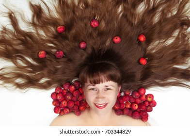 white woman with long hair and apples top view