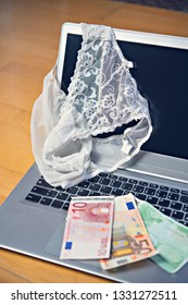 white woman panties with silver laptop- computer and money
