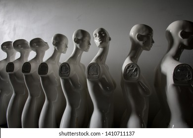 White Woman Torso Figurines Standing in The Line All Looking to Same Direction except of One, Wide angle Closeup
