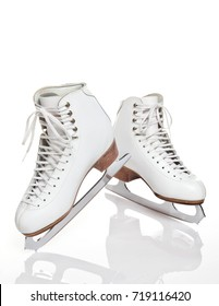 White women's figure skates on a white background with ice reflection beneath.