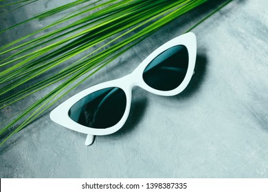 white women's sunglasses Glasses in the form of cat's eyes on a dark background