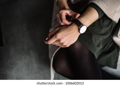 white women's wrist watch on the girl's hand