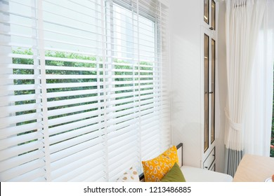 white wood blind and window at home