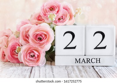 White wood calendar blocks with the date March 22 th for Mother's Day or Mothering Sunday 2020 . Selective focus with blurred background.
