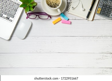 White wood desk table with laptop computer and coffee  on white wood  background. Top view with copy space, flat lay and work from home concept