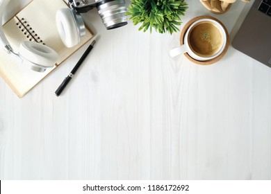 White wood desktop with office supplies. workspace and copy space.