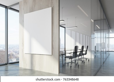 White wood office waiting area with loft windows, a concrete floor, a vertical poster and a meeting room with black chairs. 3d rendering mock up
