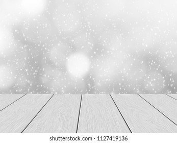 White wood planks, in the background blurred bokeh and snowfall.