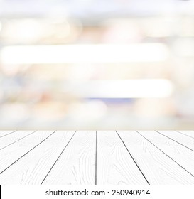 White wood table top background, Perspective wooden shelf over blur abstract bokeh light background, Empty wood counter surface and blur store, cafe, Food and product display mockup, template, banner