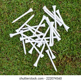 White wood tee on grass in golf course for swing practice.