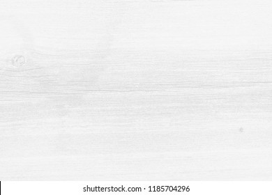 White wood texture background of distressed pine grain with knots. Natural wooden texture wallpaper.  White wooden table top view.
