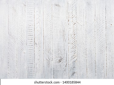 White wood texture. Wood background rustic painted and worn. Wooden table or wall top view.