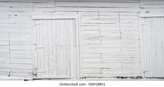 white wood wall old planks and wooden doors background texture