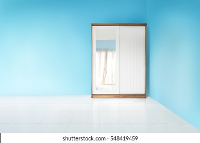 white and wood wardrobe in blue wall empty bedroom
