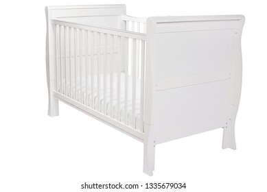 White wooden baby bed for a baby with sides on an isolated