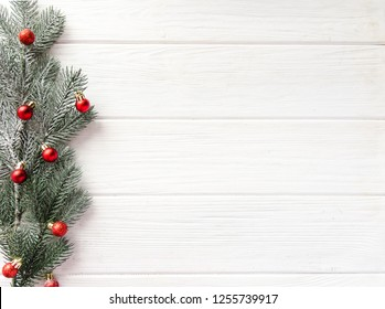 White wooden background for an inscription, a Christmas tree with red toys, decor, New Year, Christmas, copy space top view flat lay, xmax