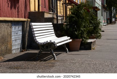 white wooden bench in the street, park bench, break. High quality photo