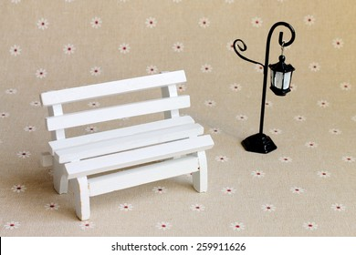 White wooden bench and streetlight miniatures for decoration