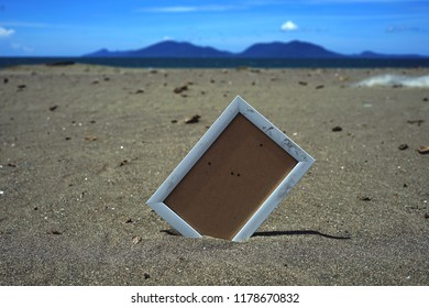 White Wooden Blank photo frames on beach sand