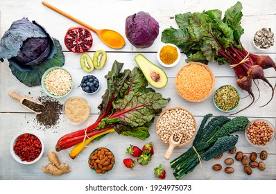 white wooden board with red vegetables cabbage turnips superfood