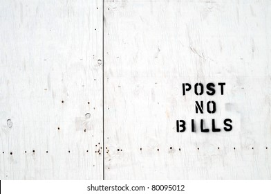 "White wooden board stamped ""Post no bills"""