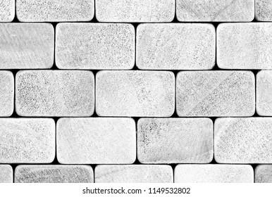 White wooden boards, battens, fence, blocks, bars, bricks, paving stones.