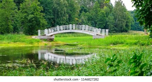 White wooden bridge in old park. Alatskivi, Estonia, Europe