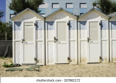 White wooden cabins on the beach.