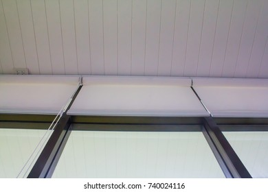 White wooden ceiling and white Blinds in the sun use sunscreen to keep warm.