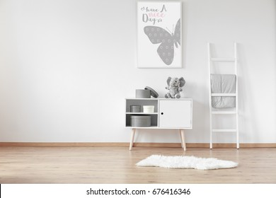 White wooden cupboard with round cardboard boxes and fluffy rug in the room