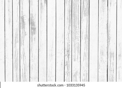 White wooden desk. Peeling paint grunge weathered wall background.