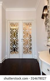 White wooden door with decorative details