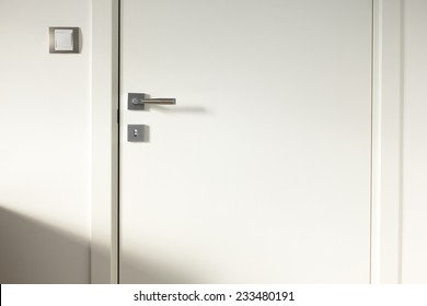 White wooden door frames door light switch