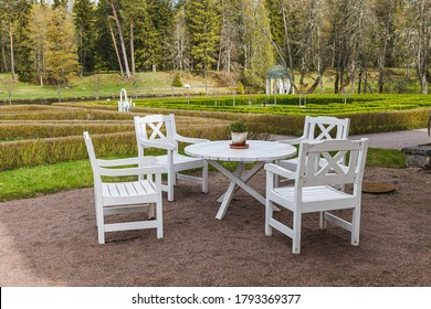 White wooden garden table and chairs with park at the background